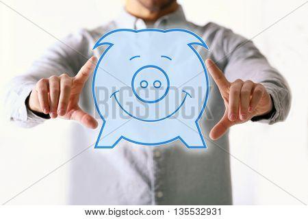 Man touching piggy bank on virtual screen
