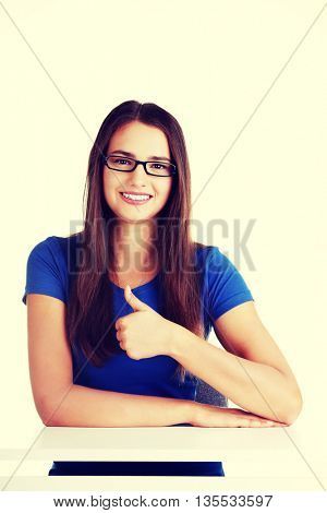 Young student woman showing OK gesture.
