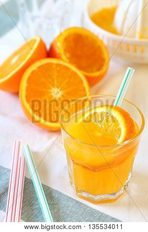 Fresh orange juice on a light background