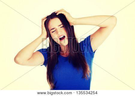 Young beautiful woman having terrible headache.