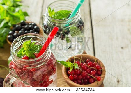 Infused water in glass jars, copy space