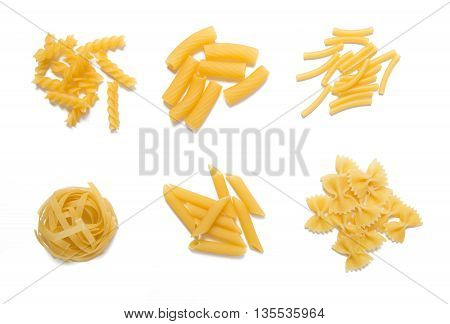 selection of pasta, isolated on white background: fussili, rigatoni, gemelli, tagliatelle, penne and farfalle