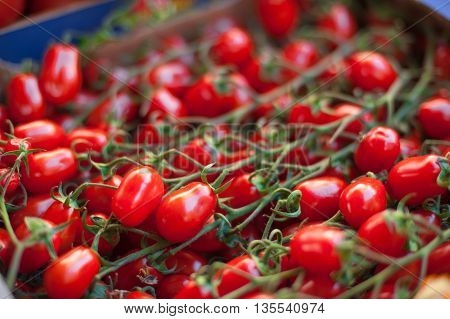 Red Cherry Tomatoes On Market Stall