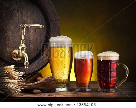 Glasses of beer on the wooden table.