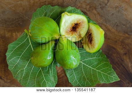 Green ripe figs fruit on wooden table one cut view from the top