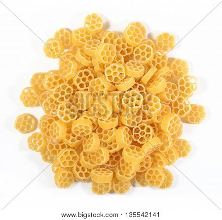 Heap Of Uncooked Italian Pasta Rotelle On A White