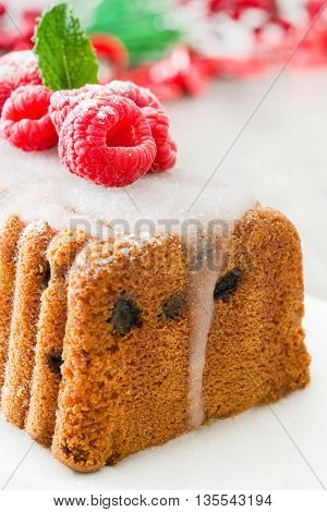 Sweet Christmas fruit cake with raspberries on white background