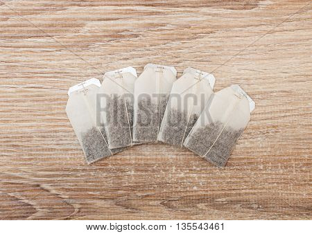 Unused Teabags In A Row On Wooden Background