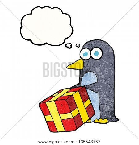 freehand drawn thought bubble textured cartoon penguin with christmas present