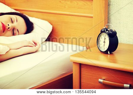 Woman is sleeping.