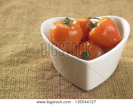 cherry tomatoes in heart shape container