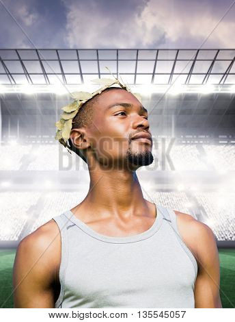 Portrait of victorious sportsman against sports arena