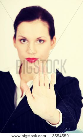 Business woman is making stop sign.