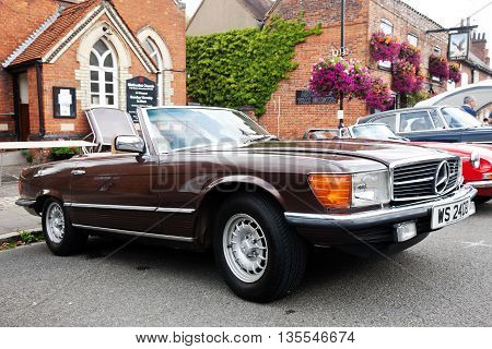 AMERSHAM, UK - SEPTEMBER 13: A vintage Mercedes convertible sportscar is parked on the side of the highway as a static display at the Amersham Heritage Day festival on September 13, 2015 in Amersham.