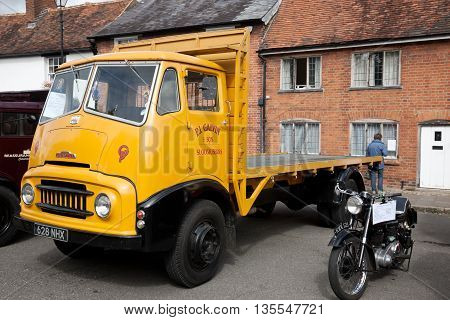 AMERSHAM, UK - SEPTEMBER 13: A vintage Austin Commercial flatbed lorry is parked on the side of the highway as a static display at the Amersham Heritage Day festival on September 13, 2015 in Amersham.