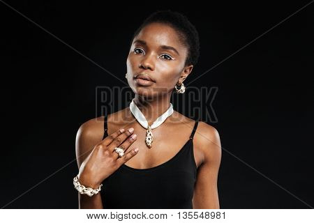 Portrait of a beautiful stylish african woman posing isolated on a black background