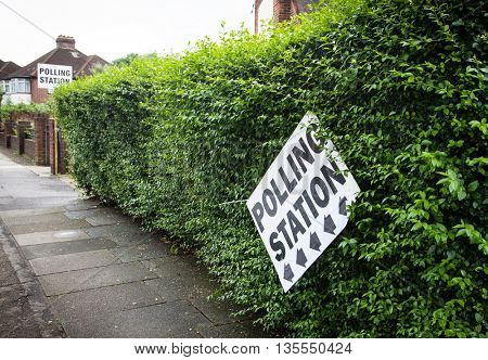 LONDON, UNITED KINGDOM - JUNE 23: A polling station sign is hanged on a wall during the British EU Referendum in London, United Kingdom on June 23, 2016.