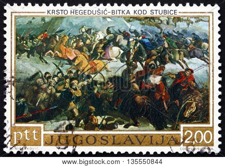 YUGOSLAVIA - CIRCA 1973: a stamp printed in the Yugoslavia shows Battle of Stubica Painting by Krsto Hegedusic Croatian-Slovenian Rebellion 400th Anniversary circa 1973