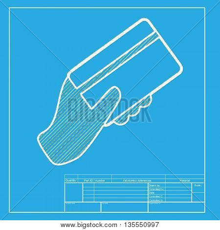 Hand holding a credit card. White section of icon on blueprint template.