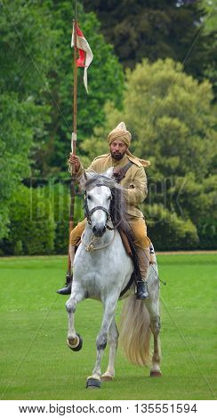 Silsoe, Bedfordshire, England - May 30, 2016:  A member of the Punjab Lancers in World War One uniform riding a white horse.