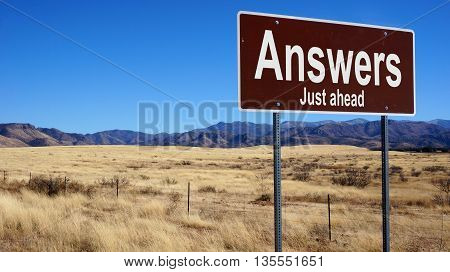 Answers road sign with blue sky and wilderness