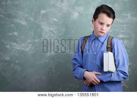 Education Concept - Schoolboy With Backpack And Book