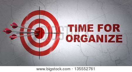 Success time concept: arrows hitting the center of target, Red Time For Organize on wall background, 3D rendering
