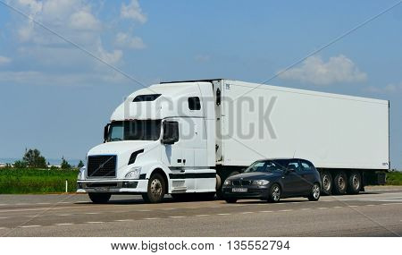 ROSTOV / DON. RUSSIA. M4-DON. June 23, 2016. The trailer transports cars on the highway M4 Don. June 16. Russia