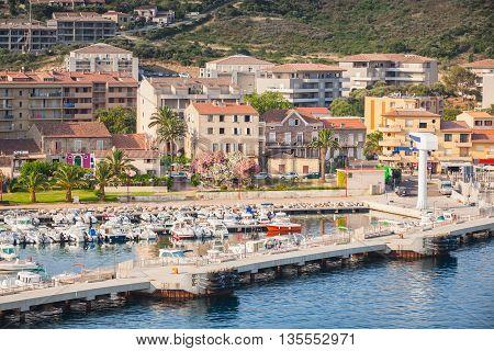 Concrete Pier With Crane In Port Of Propriano