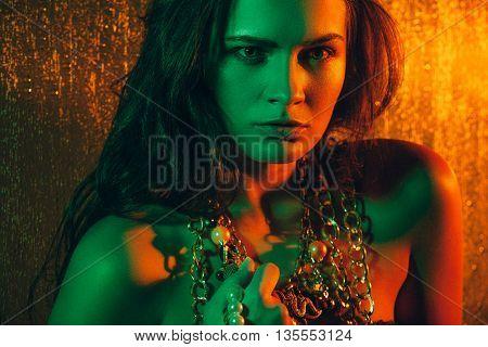 Beauty portrait of beautiful female model on an orange background. Studio shot.