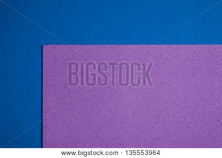 Eva foam ethylene vinyl acetate sponge plush light purple surface on blue smooth background