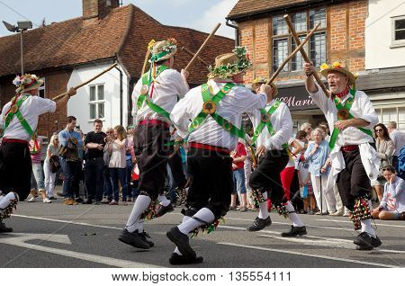AMERSHAM, UK - SEPTEMBER 7: As part of the entertainment at the annual Amersham Heritage day event Morris dancers demonstrate old English folk dancing to the public on September 7, 2014 in Amersham