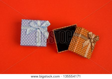 Gift Boxes In Polka Dots On Red Background