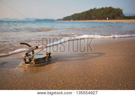 Vintage Sundial on a tropical beach