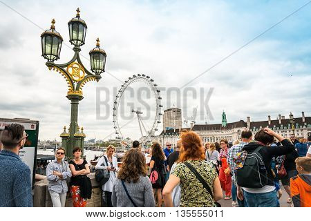 LONDON, UNITED KINGDOM - June 21, 2016. Street view of  London Eye and River Thames London, United Kingdom
