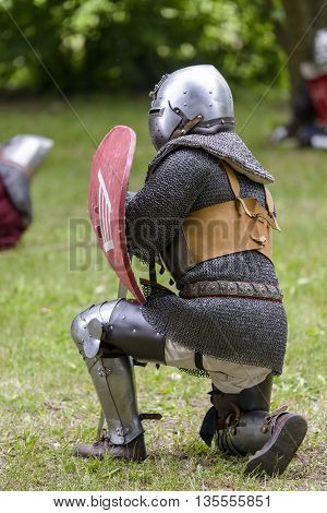 knight in armor in a medieval reenactment