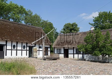 Lyngby, Denmark - June 23, 2016: Sweep well in courtyard of old danish farmhouse.