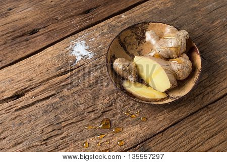 Ginger and Honey healthy for asia herb ancient therapy cold on wood background