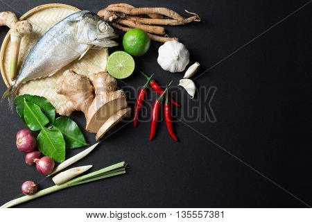 Ingredient of Tom Yum spicy soup With steamed mackerel Fish Traditional Thai food cuisine on black background