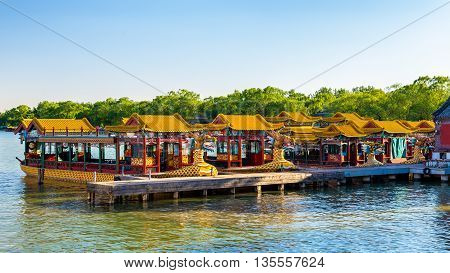 Traditional Chinese boats on Kunming Lake at the Summer Palace in Beijing