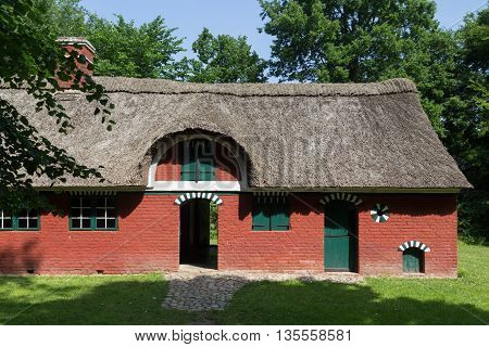 Lyngby, Denmark - June 23, 2016: An ancient danish farmhouse with straw roof in Frilands Museum.