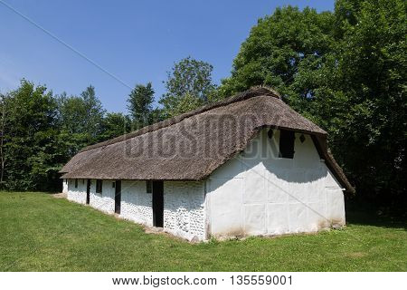 Lyngby, Denmark - June 23, 2016: An ancient danish half-timbered farmhouse with straw roof in Frilands Museum.