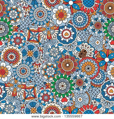 Beautiful background composed of multi colored floral designs and intricate geometric full frame patterns