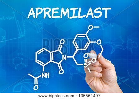 Hand With Pen Drawing The Chemical Formula Of Apremilast