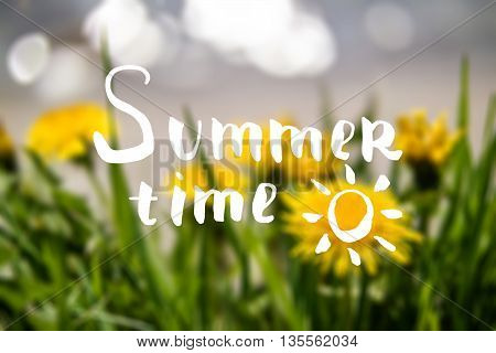 Summer time hand drawn lettering. Hand drawn phrase Summer time on the yellow dandelions and grass blured background. Inscription for summer card banner poster party invitation or t-shirt design.