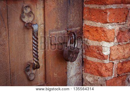 The old door is locked on the padlock