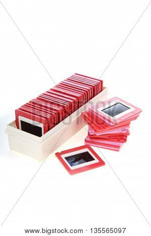Old slides and projector isolated on a white background