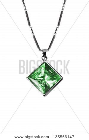 Emerald pendant on silver chain isolated over white