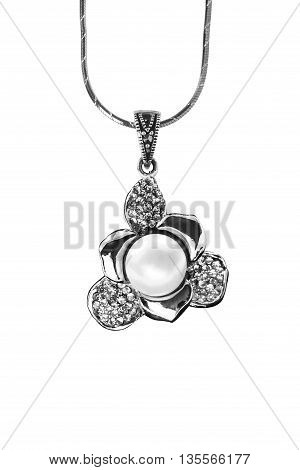 Silver flower shaped pendant isolated over white