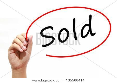 Man Hand writing Sold with marker on transparent wipe board. Business internet technology concept.